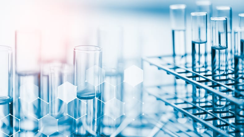 Laboratory glassware containing chemical liquid, science background